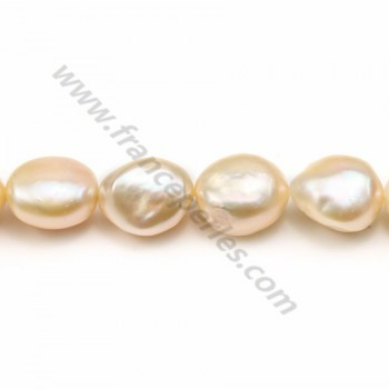 Salmon color oval freshwater pearls on thread 13-15mm x 40cm